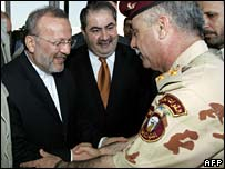 Manouchehr Mottaki, Hoshyar Zebari and an unknown Iraqi security officer