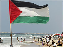 Palestinians on the beach at Gaza City