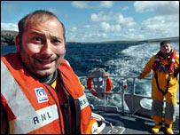 Shahid Naqvi on lifeboat (Pic: Birmingham Post)
