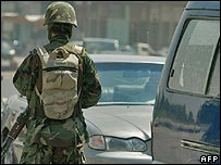 Iraqi policeman at a checkpoint in Baghdad
