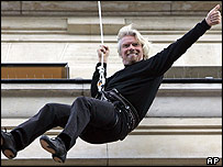 Richard Branson abseiling down a building