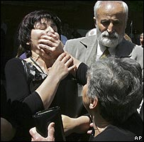 Relatives of victims of the Beslan school siege scuffle