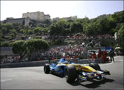 World champion Fernando Alonso rounds the first corner, Ste Devote, as he familiarises himself with his Renault