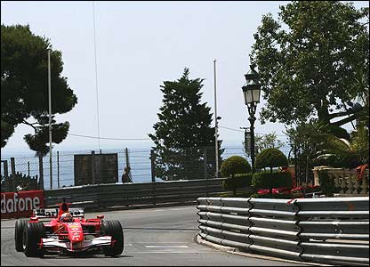 Felipe Massa wrestles his Ferrari through Massenet with the Mediterranean glinting in the background