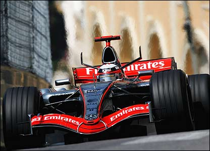 Kimi Raikkonen blasts up the steep hill towards the tricky Massenet bend in his McLaren