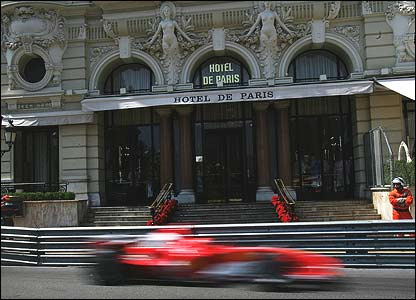 Michael Schumacher's Ferrari screams past the famous Hotel de Paris in Casino Square