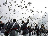 Graduating cadets threw their caps into the air
