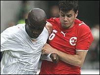Ivory Coast's Marc Zoro and Switzerland's Tranquillo Barnetta