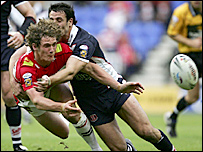 Wigan's Sean O'Loughlin gets the ball away under intense pressure