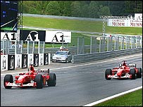 Michael Schumacher crosses the line after team-mate Rubens Barrichello moved over to let him past on the last lap in Austria in 2002