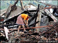 Woman searches in the wreckage in Yogyakarta city, Java