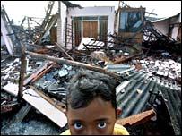 Boy guarding house in Bantul