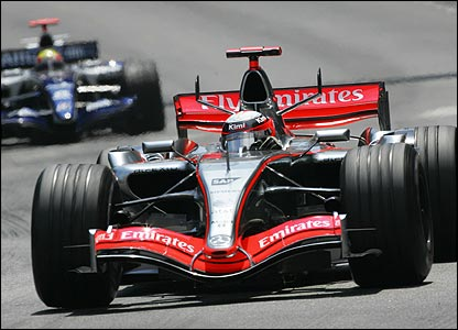 Kimi Raikkonen leads Mark Webber on the second lap
