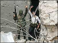 PFLP guerrillas after their base was attacked by Israeli jets