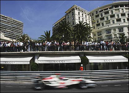 Honda's Jenson Button is cheered on by spectators