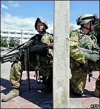 Australian soldiers patrol Dili