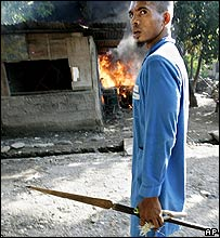 East Timorese man, armed with spear