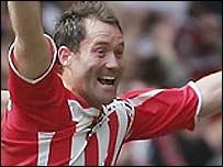Cheltenham striker Steve Guinan celebrates his winner against Grimsby