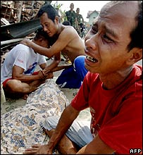 Men mourn a member of their family killed in the quake