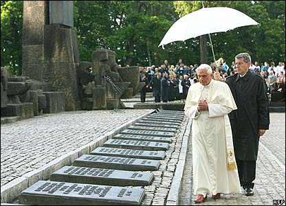 Pope Benedict looks at the tablets at the memorial to victims