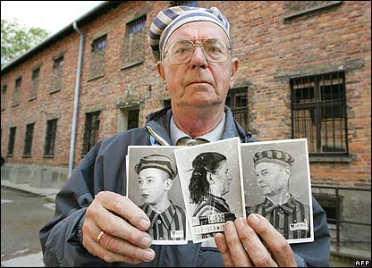 Former Auschwitz prisoner, Michnol Jerzy, shows pictures of his parents