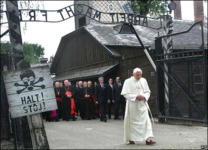 Pope walks through gate of Auschwitz camp