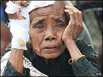 An elderly injured woman at a Red Cross refugee camp