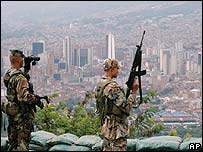 Soldiers stand guard in Medellin