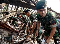 Soldiers search through the rubble of a destroyed house in Yogyakarta