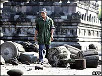 A guard surveys the damage at Prambanan temple