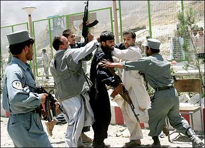 Afghan police arrest a rioter