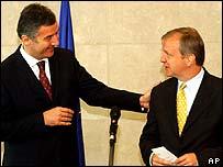 Montenegro's Prime Minister Milo Djukanovic (left) and Olli Rehn