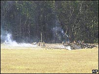 Emergency workers mark off the crash site of United Airlines Flight 93 near Somerset, Pennsylvania