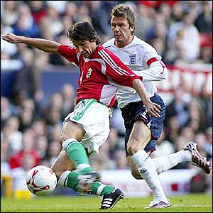 Peter Halmosi shields the ball from England's David Beckham
