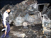 The remains of a car bomb which killed 12 in Hilla, south of Baghdad