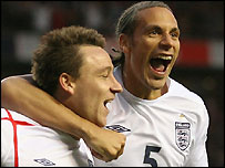 John Terry and Rio Ferdinand celebrate the second goal