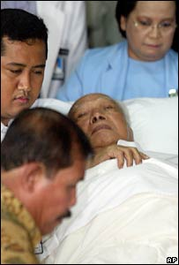 Mr Suharto is loaded onto an ambulance after being discharged from hospital in Jakarta