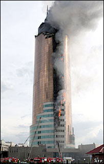 Kazakh firefighters extinguish a fire in the tallest administrative building in Kazakhstan's capital Astana, 30 May 2006