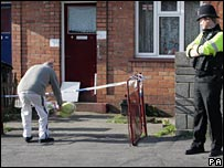 Neighbour lays flowers at scene of stabbing in Bristol