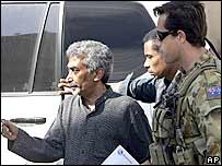 East Timorese Prime Minister Mari Alkatiri, left, is escorted by an Australian soldier into the offices of President Xanana Gusmao in Dili, East Timor, Tuesday, May 30, 2006.