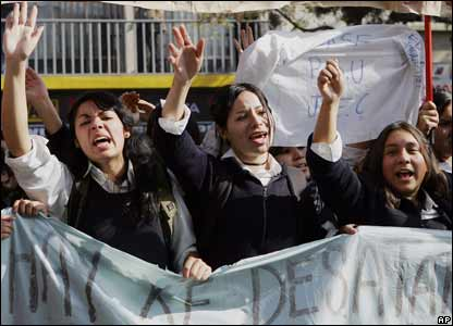 Schoolgirls chant slogans during demonstrations in Santiago