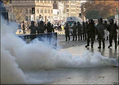 Riot police fire tear gas on the streets of Santiago