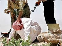 Plainclothes police arrest a suspected militant near Basra