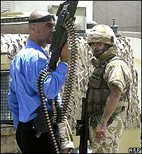 Iraqi policeman and British soldier in Basra
