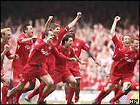 Liverpool players celebrate winning the FA Cup