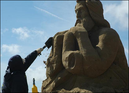 Sculptor working in sand