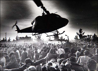 The Ayatollah's helicopter landing at Behesht a-Zahra martyrs cemetery on his return to Iran