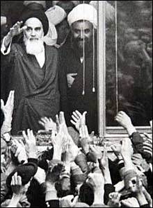 Ayatollah Khomeini waves to the crowds