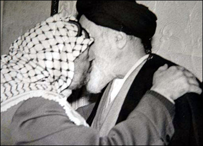 PLO chairman Yasser Arafat greeting the Ayatollah on his return from exile