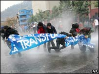 Police fire water cannon at student protesters in Santiago